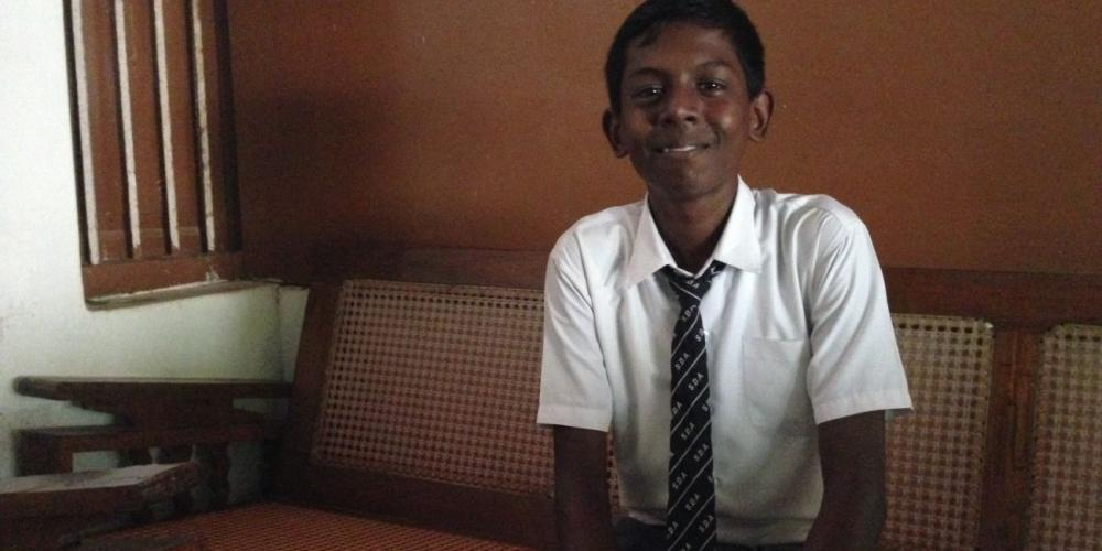 Sundar Sivasubramanian, pictured at James Memorial Higher Secondary School in India, looks younger than 16, and his bashful smile hides the reality that he's experienced more sorrow than many his age. He is in the ninth grade. (Andrew McChesney / Adventist Mission)