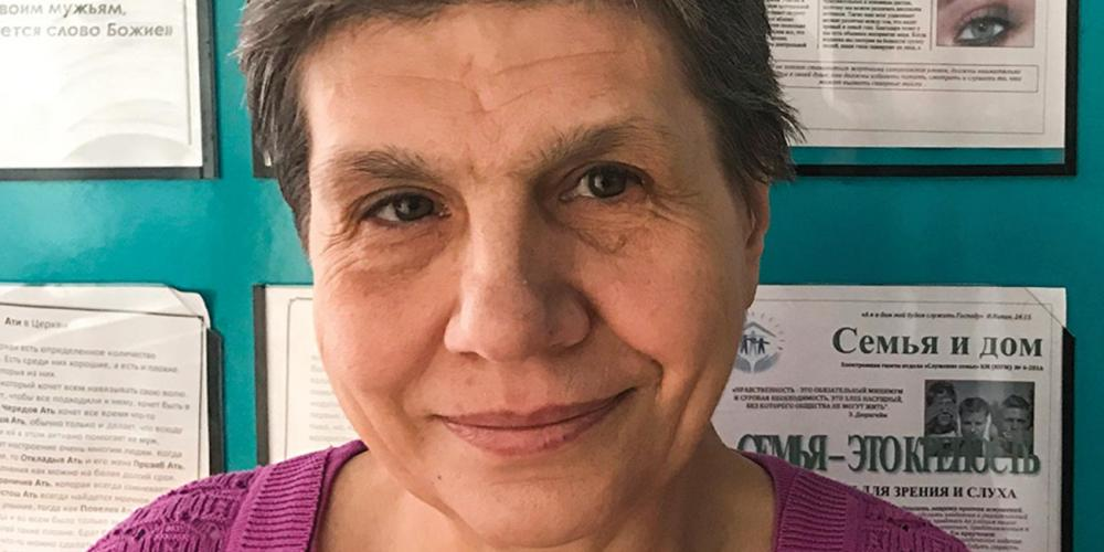 "Tatyana Pashinko, 60, pictured by a bulletin board in the Southern Seventh-day Adventist Church, says, ""I never made a mistake in all my years of work, and I only got into trouble because I wanted to obey God."" (Andrew McChesney / Adventist Mission)"