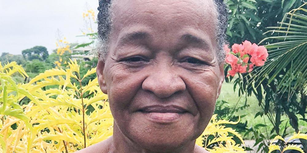 Sadie McKenzie, 63, outside her farmhouse in the Central American country of Belize. (Andrew McChesney / Adventist Mission)