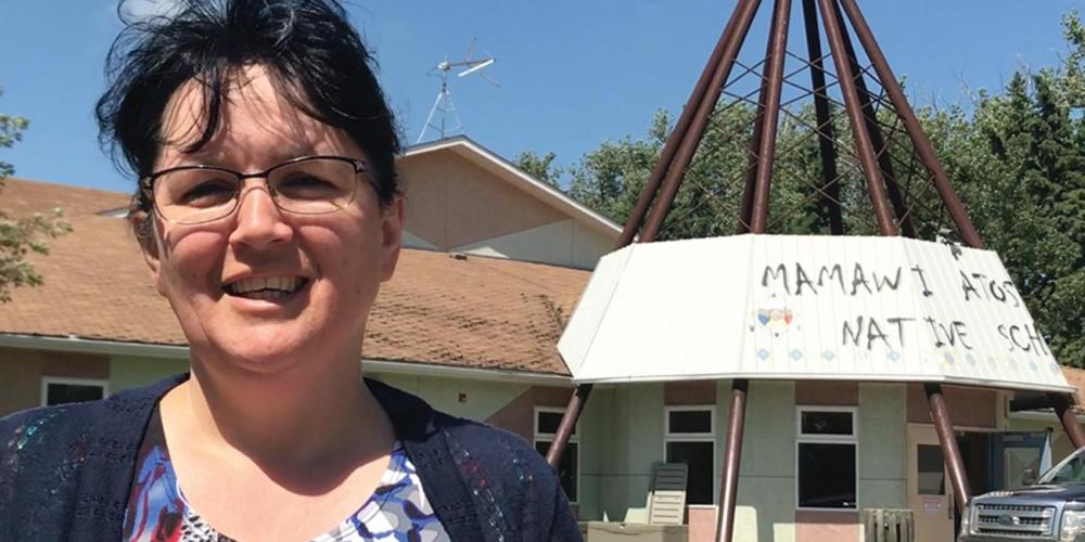 Principal Gail Wilton, 51, standing outside the main building at Mamawi Atosketan Native School. (Andrew McChesney / Adventist Mission)