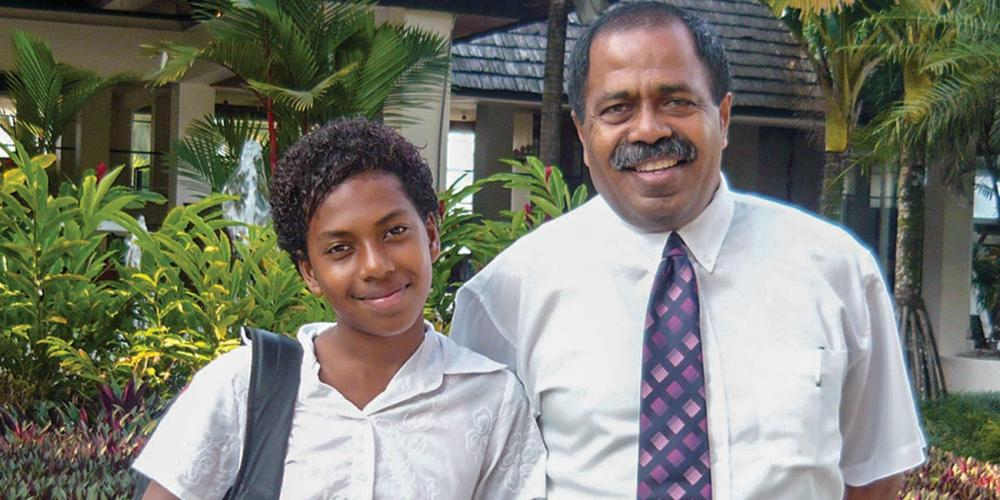 Litea Cavalevu, 15, with her father, Save.