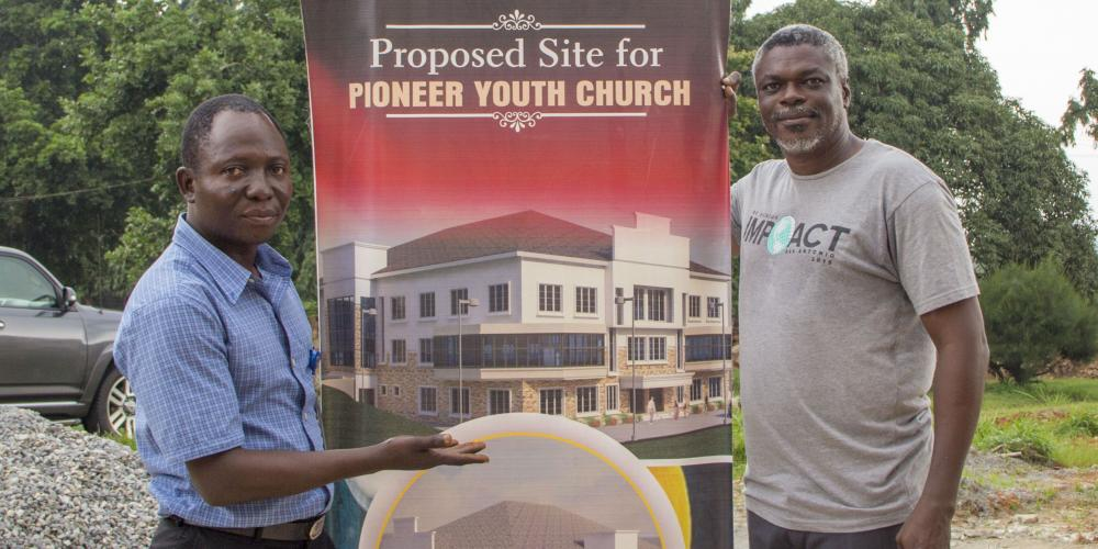 Pastors Goa Adeniran and Oyewole Oyerinde show the proposed site for the multipurpose center at Babcock University in Nigeria. Your support of the 13th Sabbath Offering will help make this resource possible!
