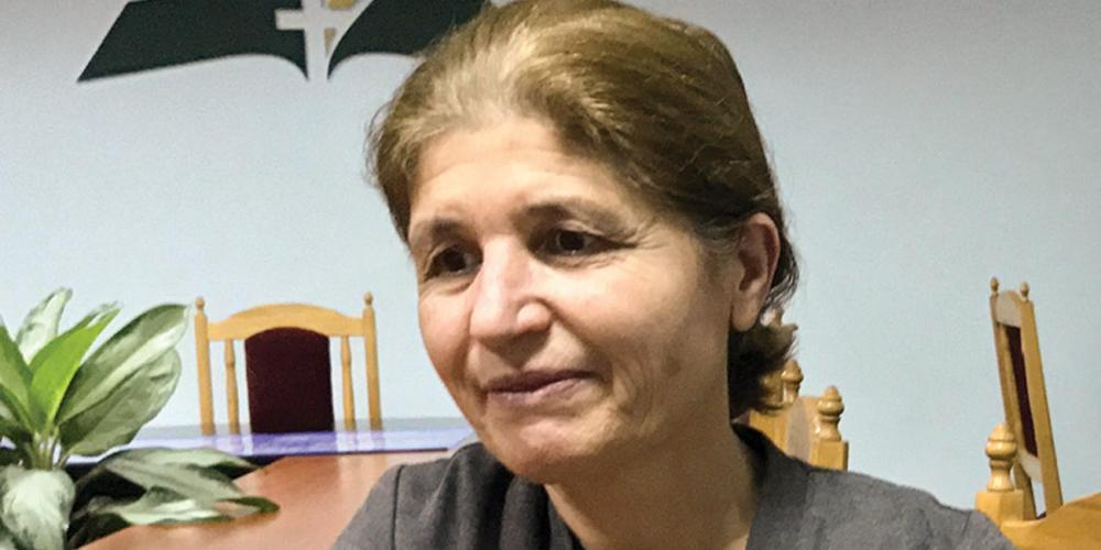 "Nadezhda Raya, 54, says, ""I found the priest and told him, 'I have come to buy a Bible. I have an Adventist Bible, and I want to compare it with the Orthodox Bible.'"" (Andrew McChesney / Adventist Mission)"